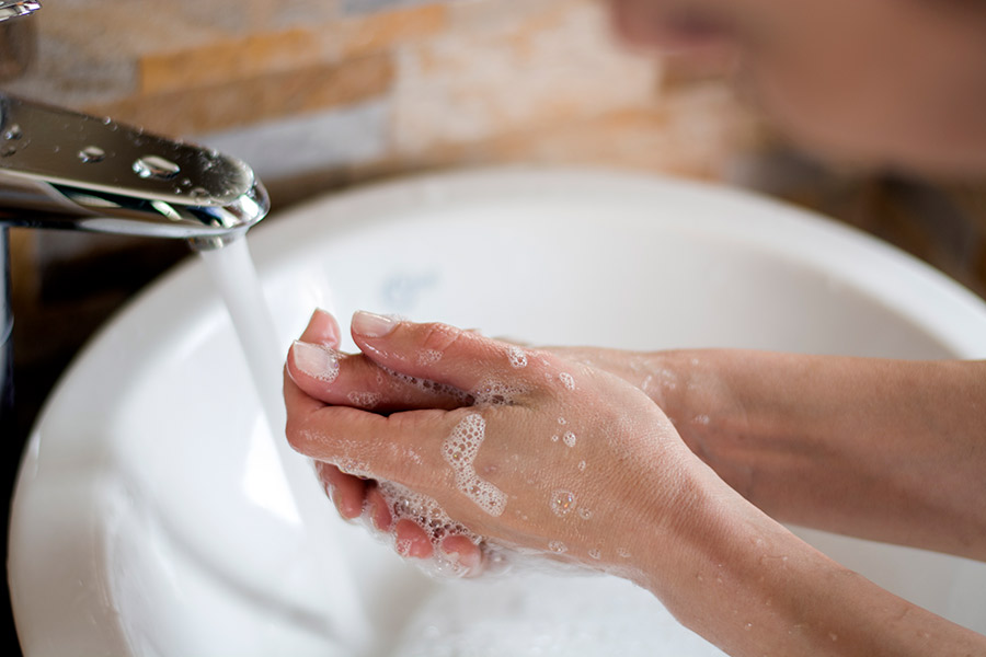 Wash your hands for at least 20 seconds with soap and warm water